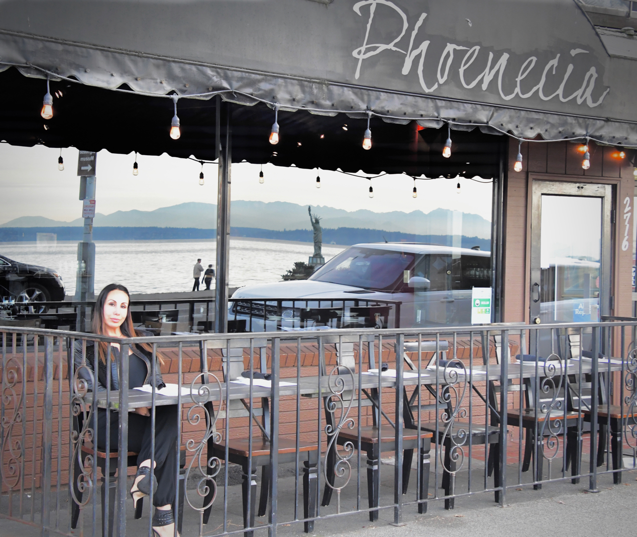 Sonya Khazaal in front of her family's restaurant The Phoenecia on Alki Beach. Photo by Patrick Robinson