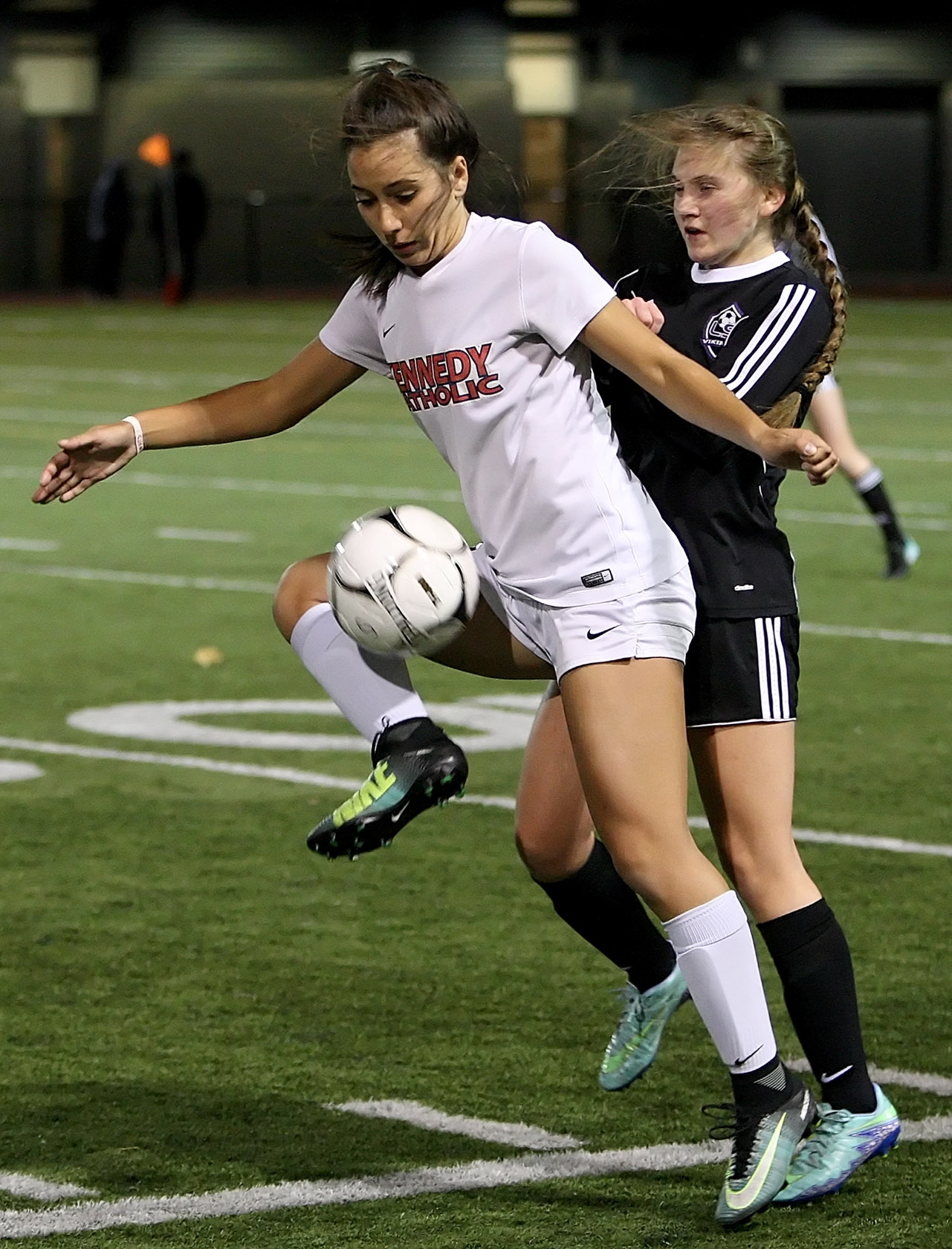 Natalie DeGagne of Kennedy Catholic keeps the ball away from Lake Stevens Jocelyn Lillesaka.