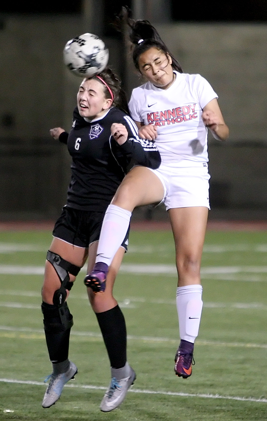Sam Foly of Lake Stevens and Kennedy Catholics Julie Trejo-Lamphere go for a header.
