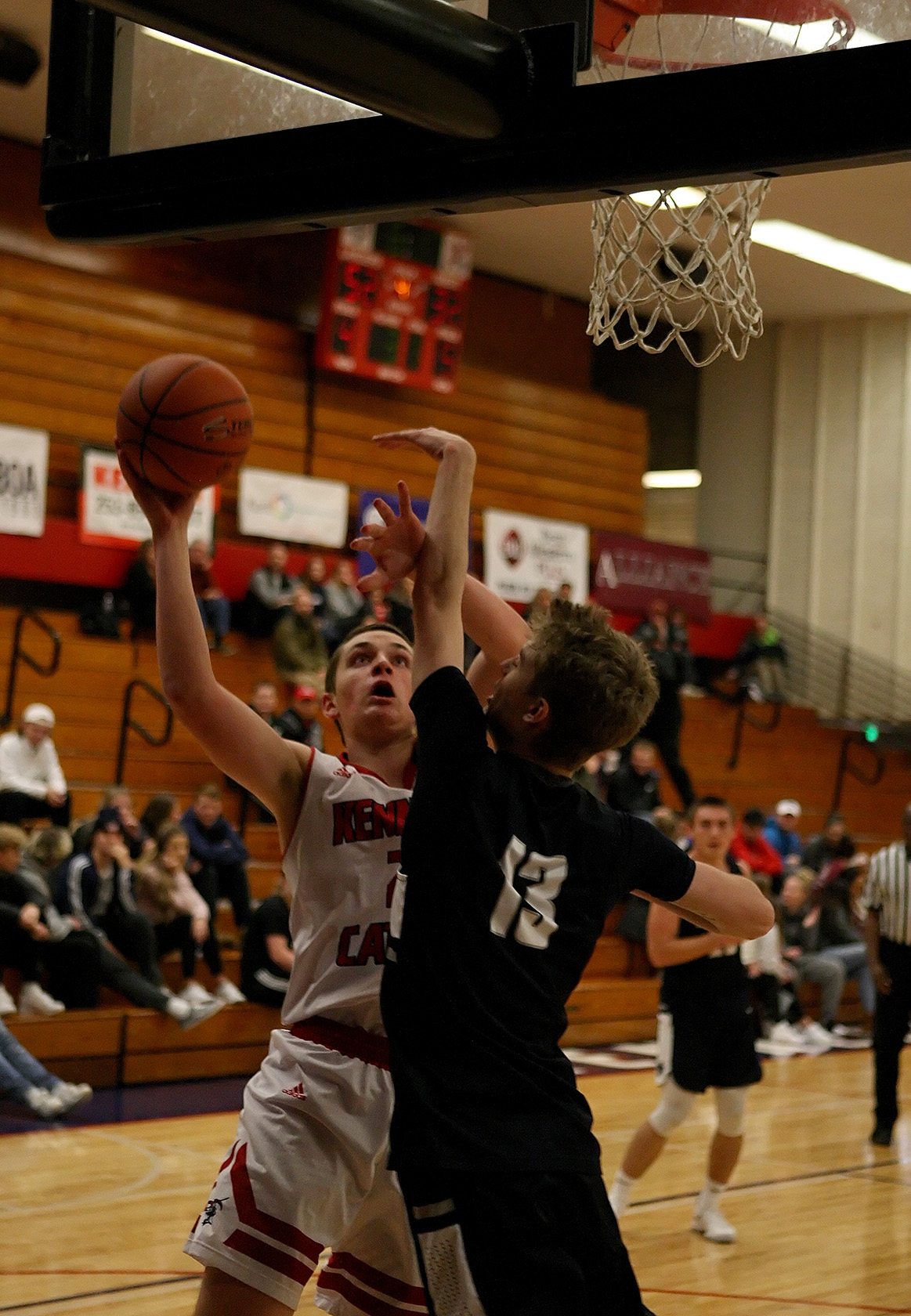 Michael Spitzer of Kennedy Catholic puts up a shot against Cascade Christian's Noah Wilkins.