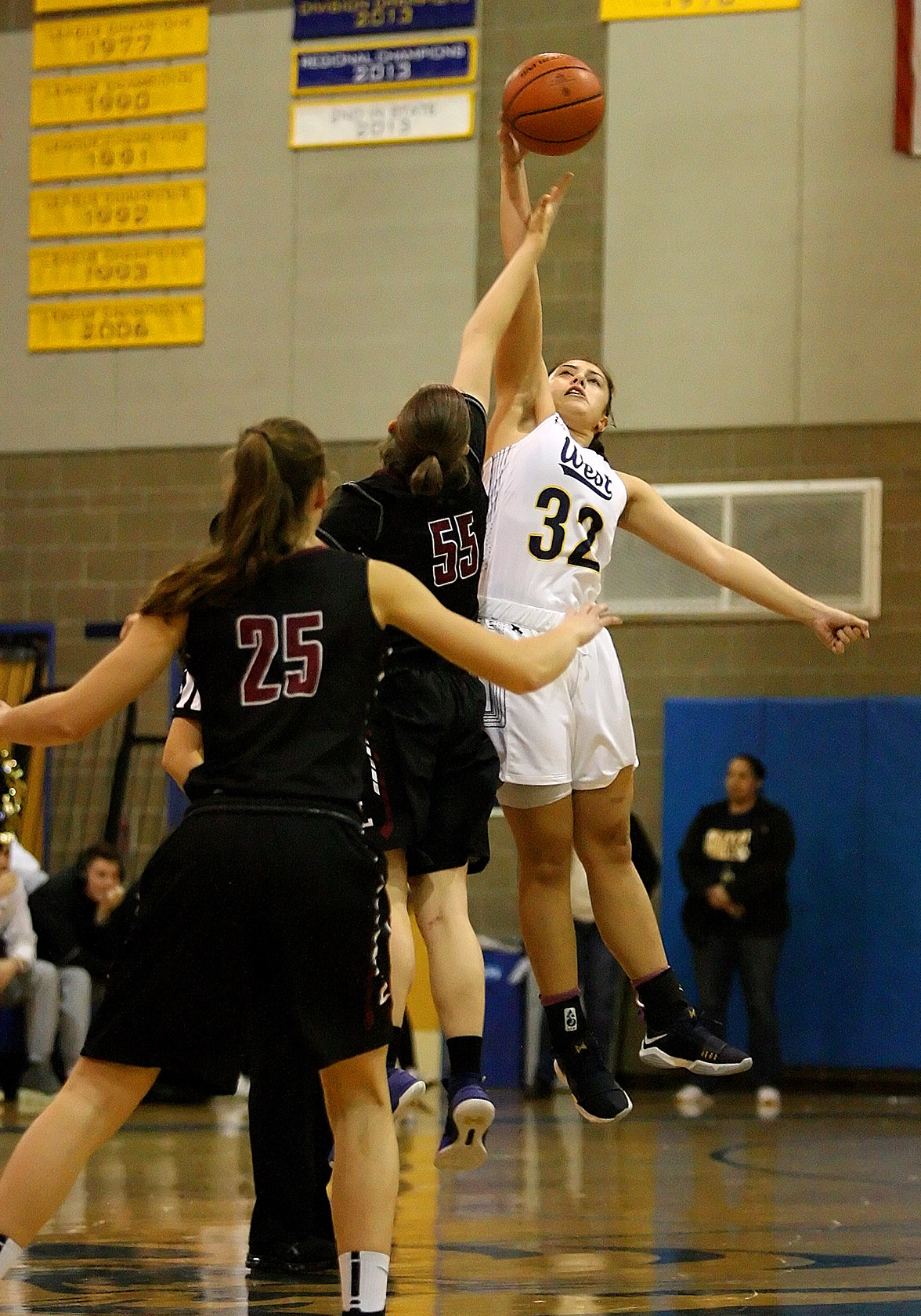 Opening tip off has Megan Fiso of West Seattle jumping against Lakeside's Grace Harrington.