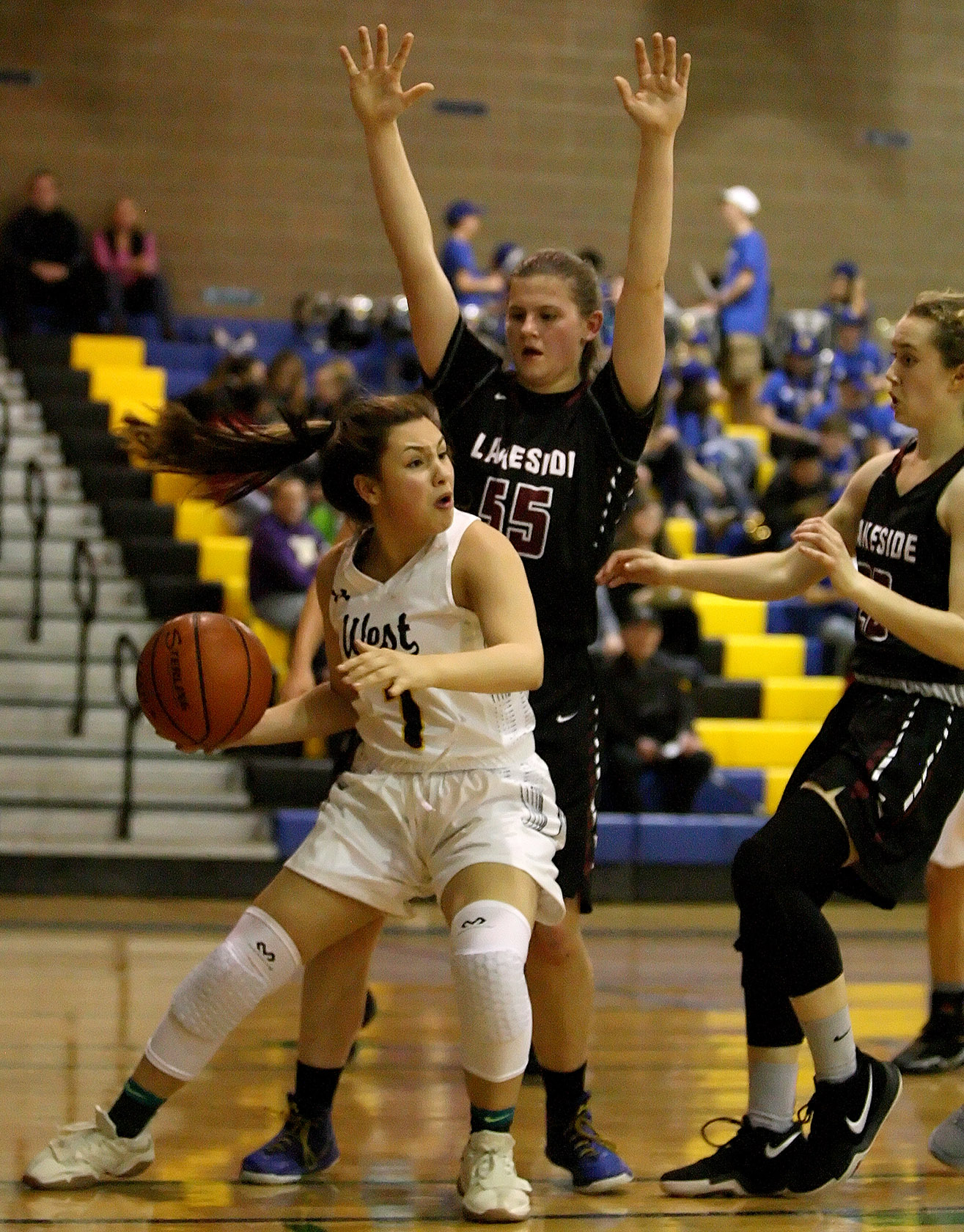 Kaiya Mar of West Seattle finds herself trapped under the basket looking to pass.