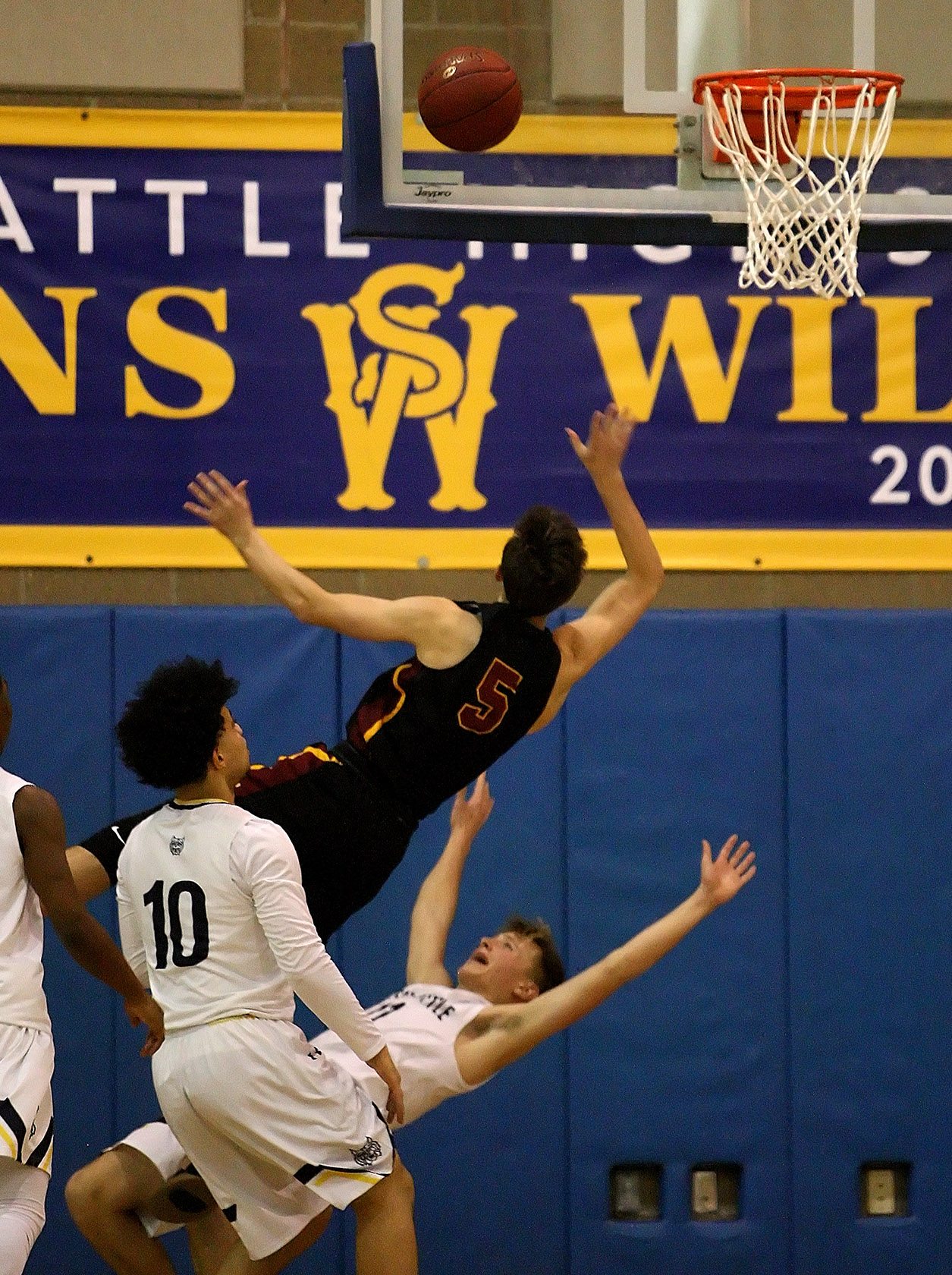 Jackson Golgart of West Seattle takes a charge from Lakeside's Alex Malcolm.