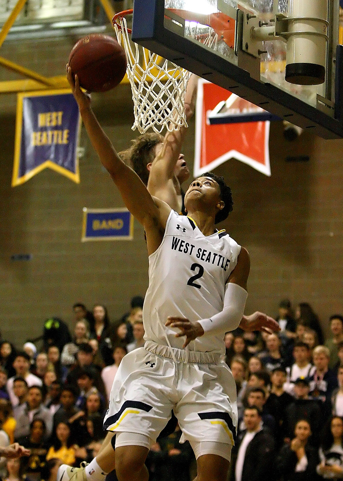Elijah Nnanabu of West Seattle makes a reverse layup against Lakeside's Max Knight.