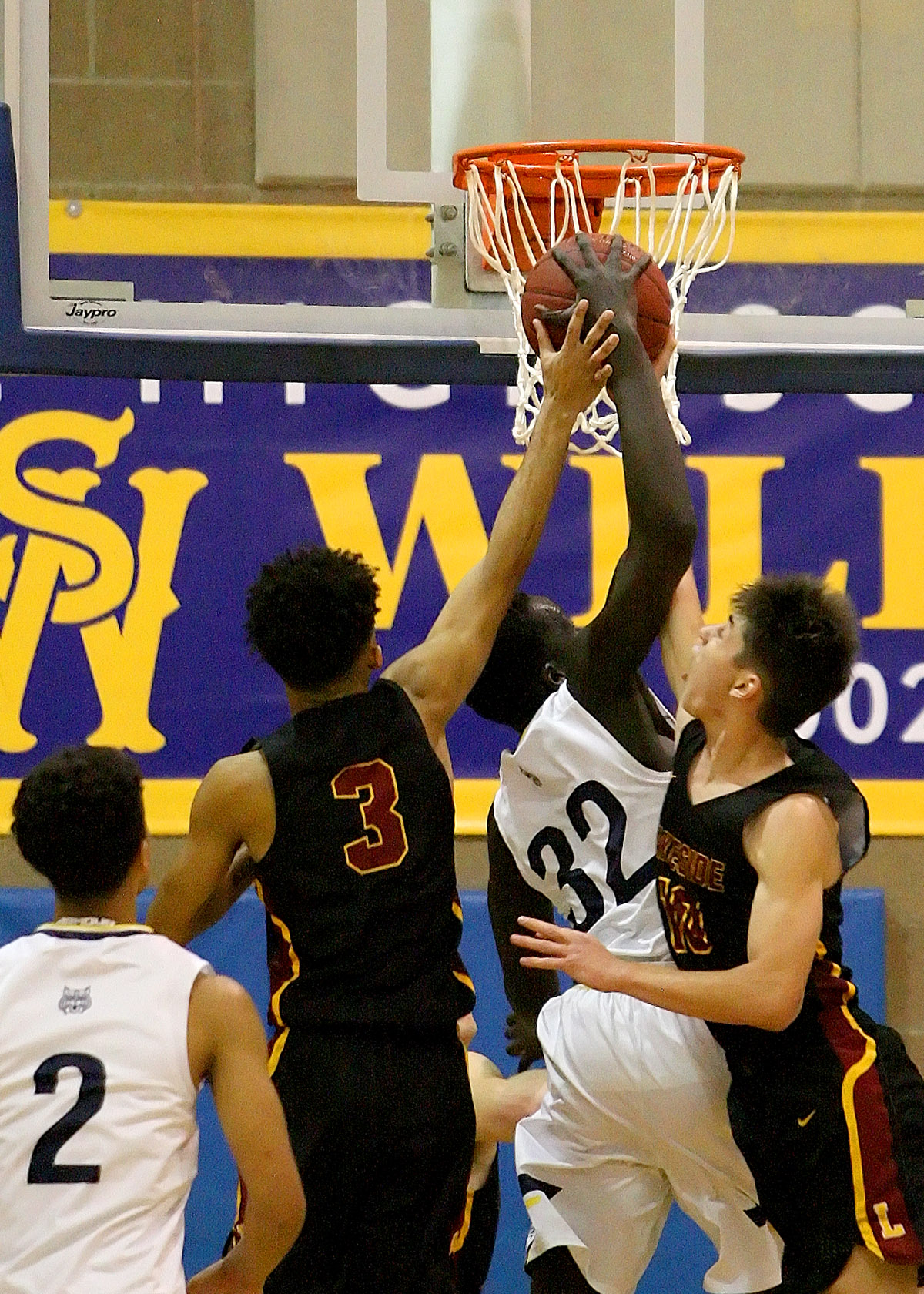Maar Rambang of West Seattle fights for a rebound against Lakeside's Omahre Gratton and William Barton.