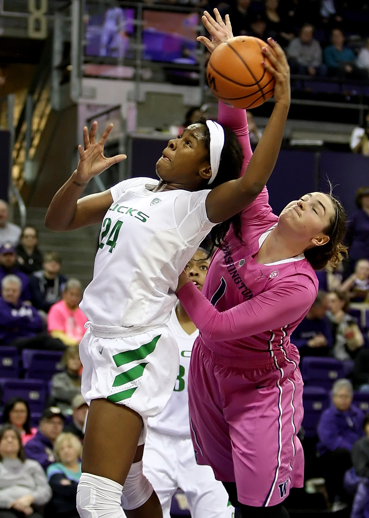 Ruthy Hebard of Oregon and Washington's Hannah Johnson fight for a rebound.