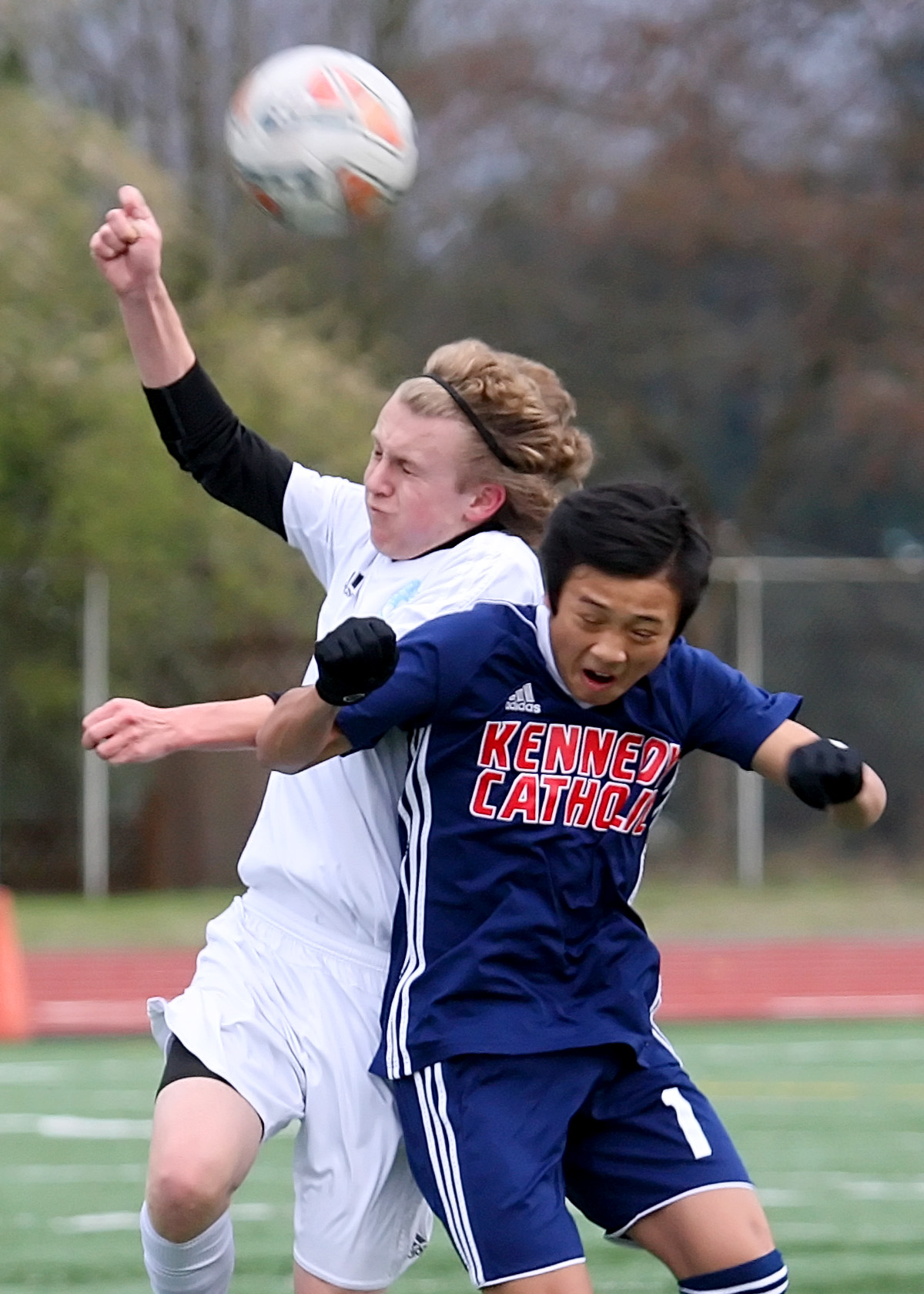 Jake Sylvester of Mt. Rainier and Kennedy Catholic's Julius Nguyen collide trying to head the ball.