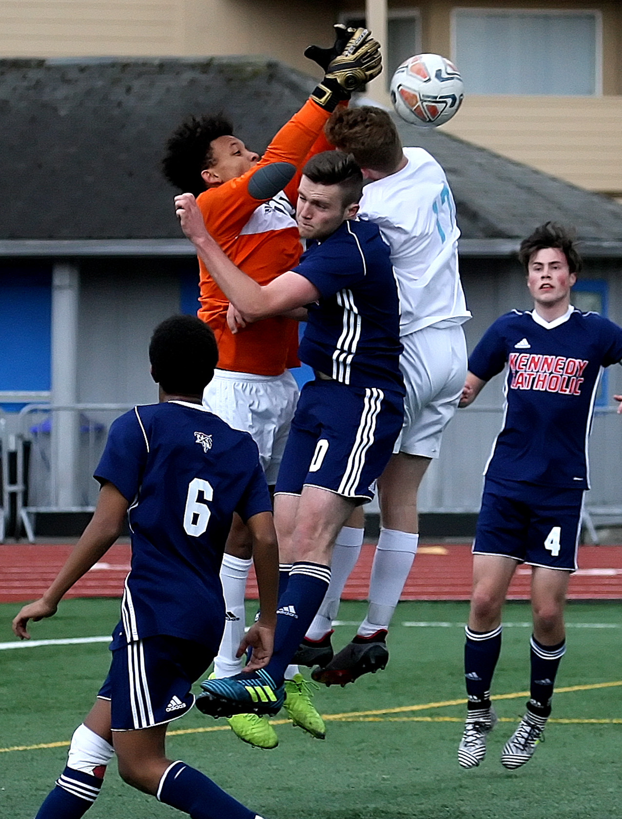 Kennedy Catholic's goalie tries to grab the ball in a crowd.