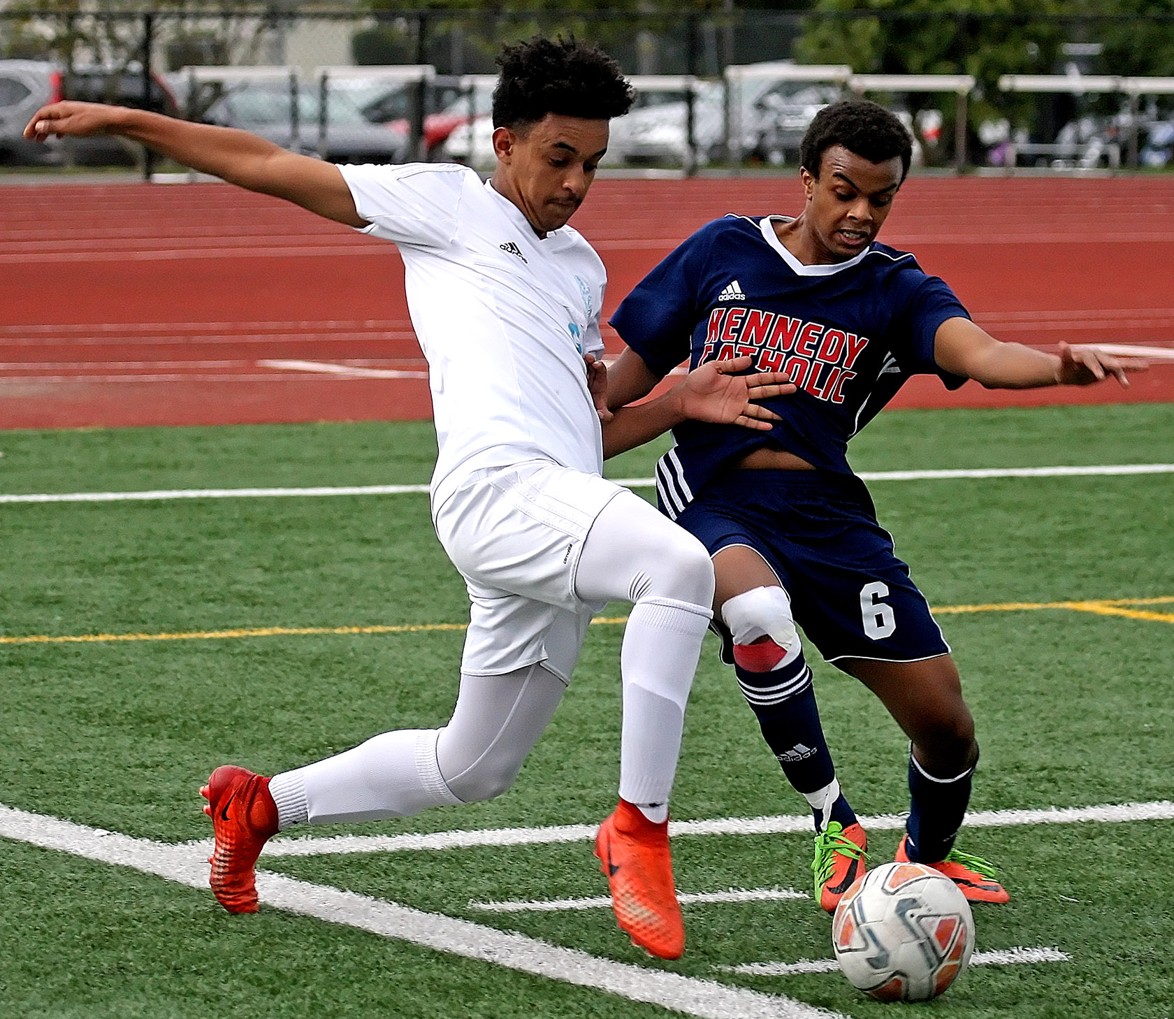 Michael Fikadu of Mt. Rainier and Kennedy Catholic's Phanuel Araya go for the ball.