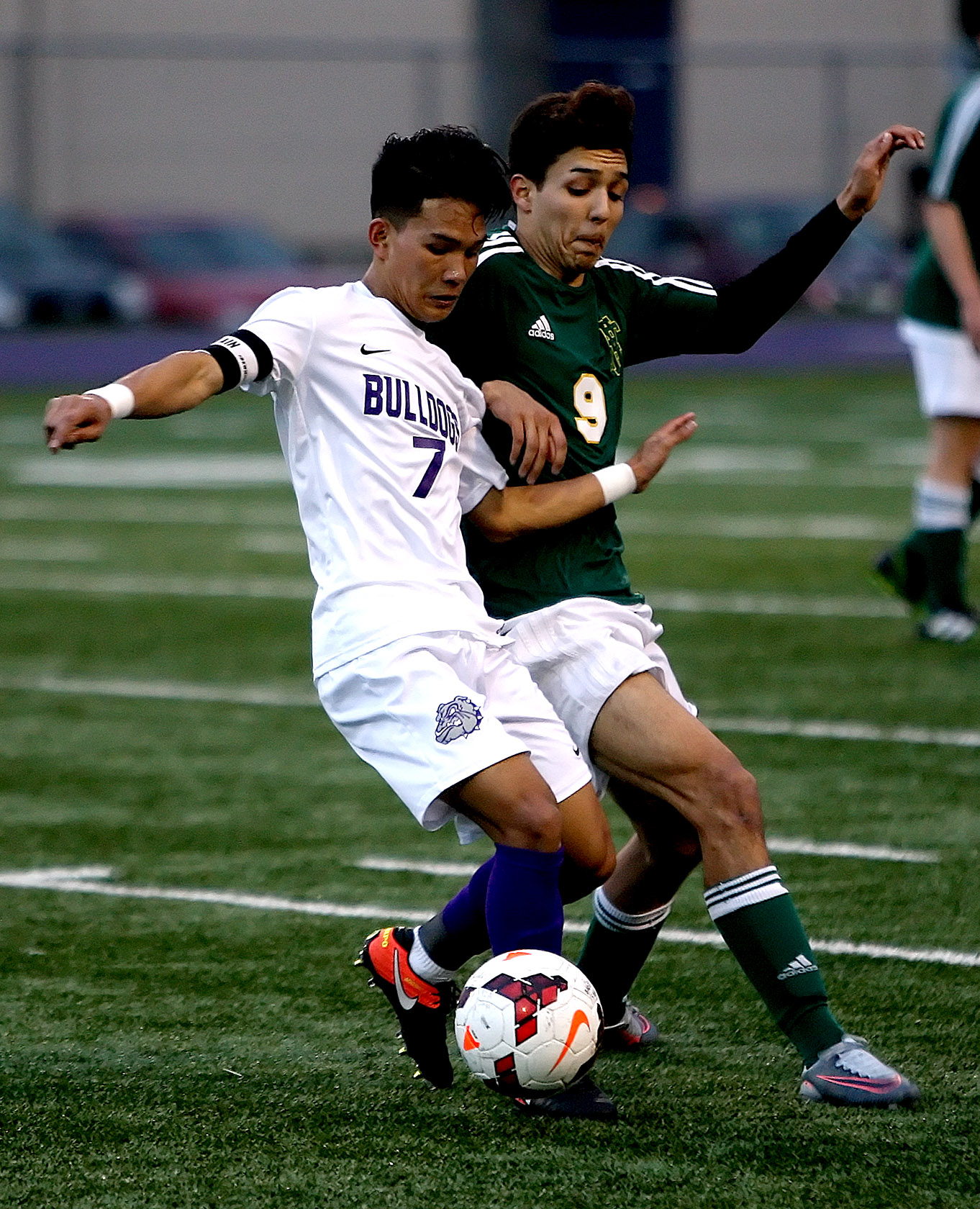 Bik Ceu of Foster gets his foot on the ball against the pressure from Foss's Jacob Rodriguez.