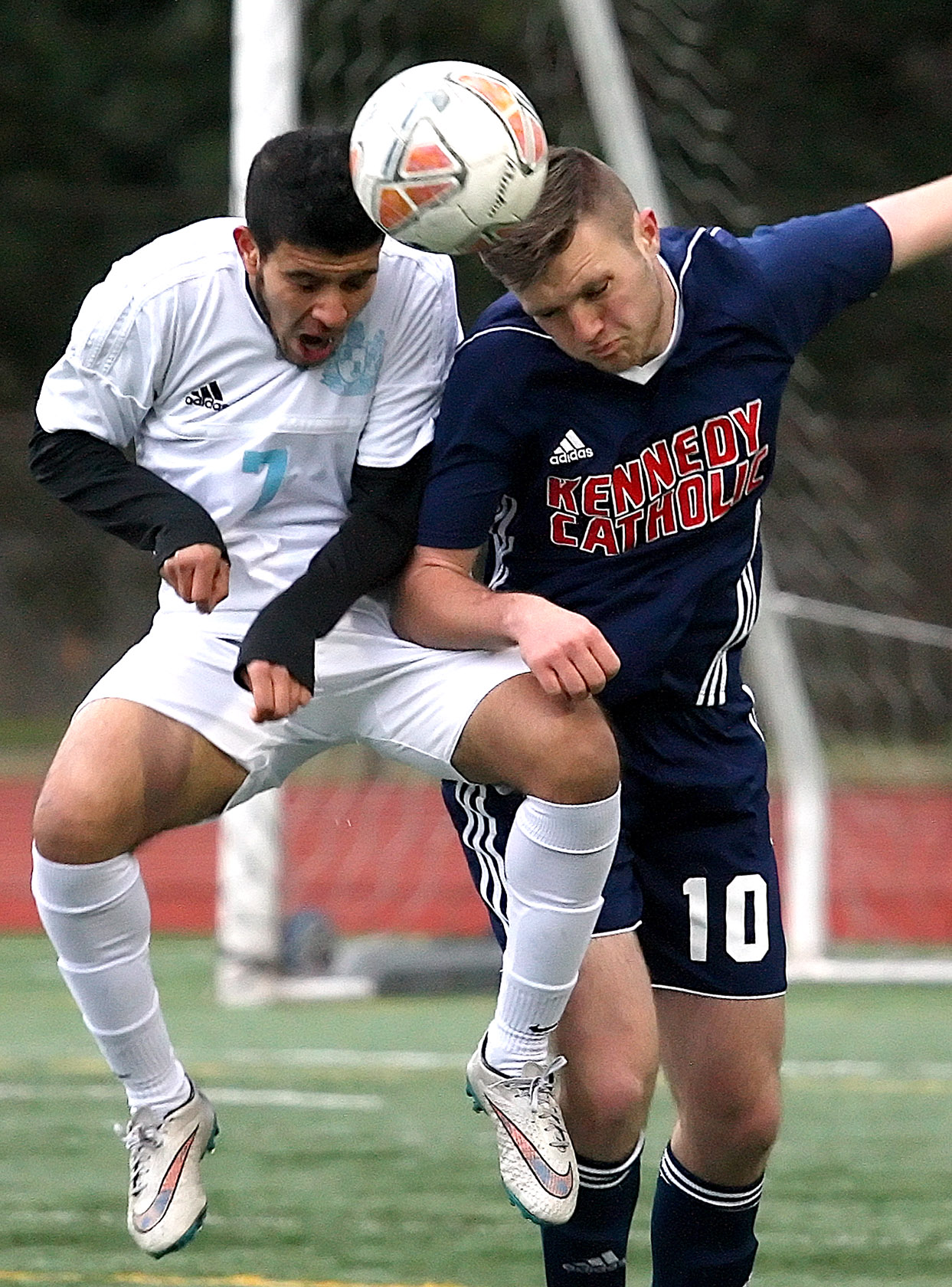 Mustafa Alobaidi of Mt. Rainier and Kennedy Catholic's Aiden Berg both head the ball.