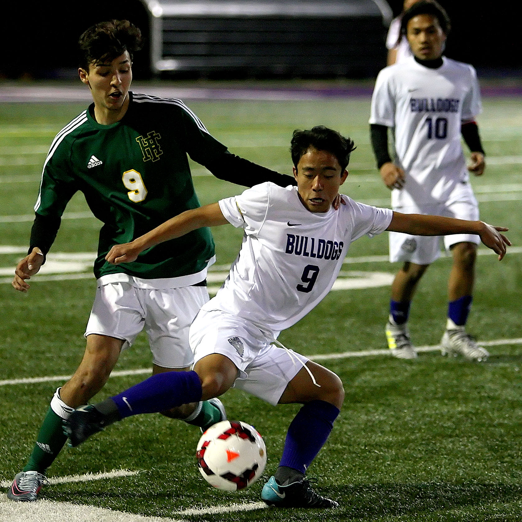 Gin Piang of Foster controls the ball against Foss's Jacob Rodriques.