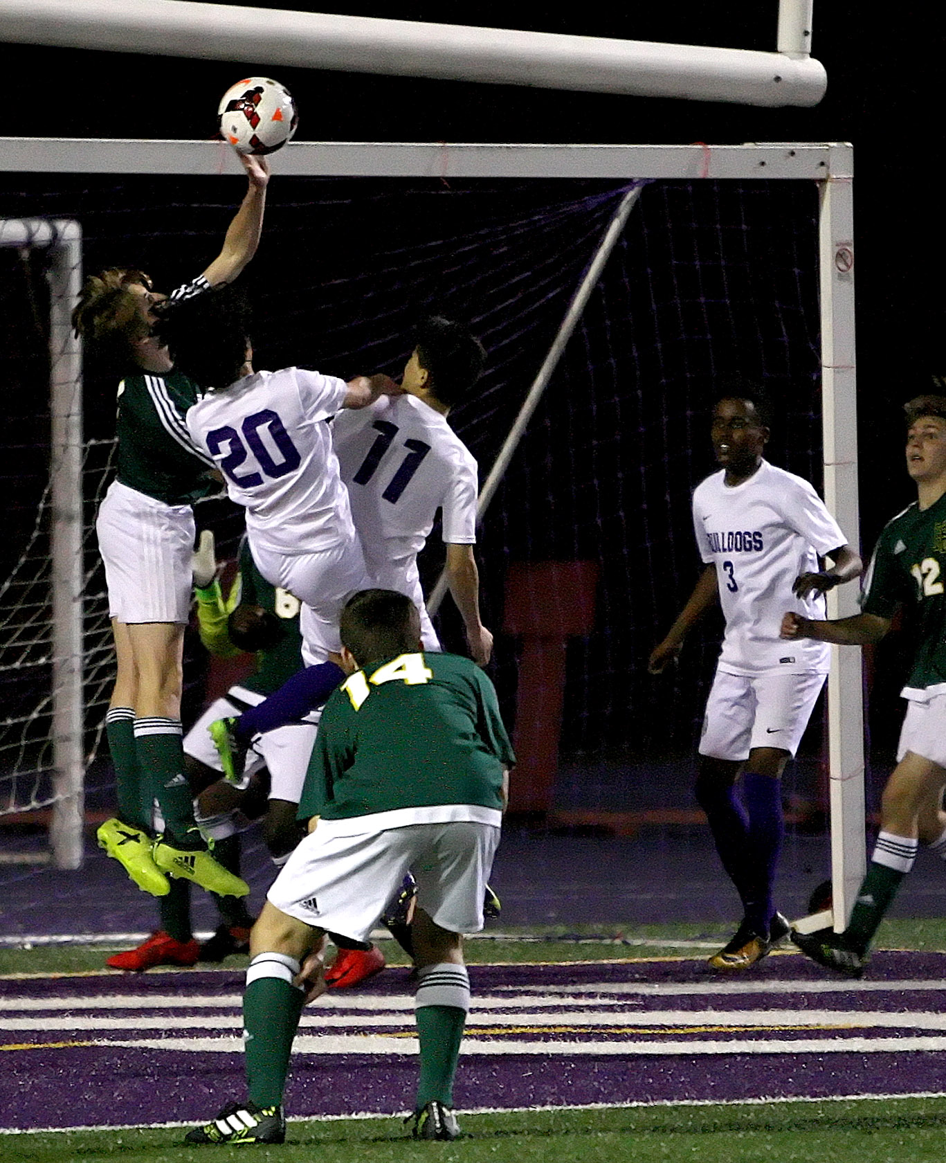 Alex Lyro of Foss blocks the shot at the goal. Wait, this isn't basketball and he isn't the goalie. PENALTY!
