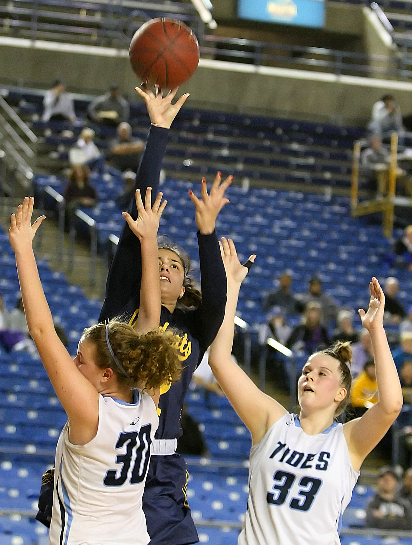 Meghan Fiso of West Seattle makes a jump shot against defensive pressure from Gig Harbors Grace Neil and Maddie Willett.