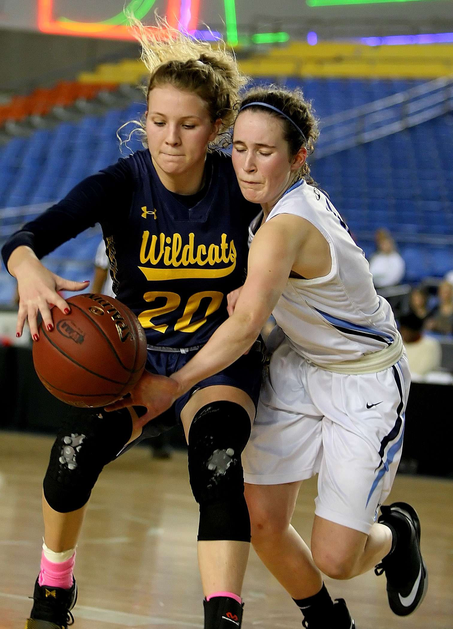 Grace Sarver of West Seattle and Gig Harbors Anna Stewart reach for a loose ball.