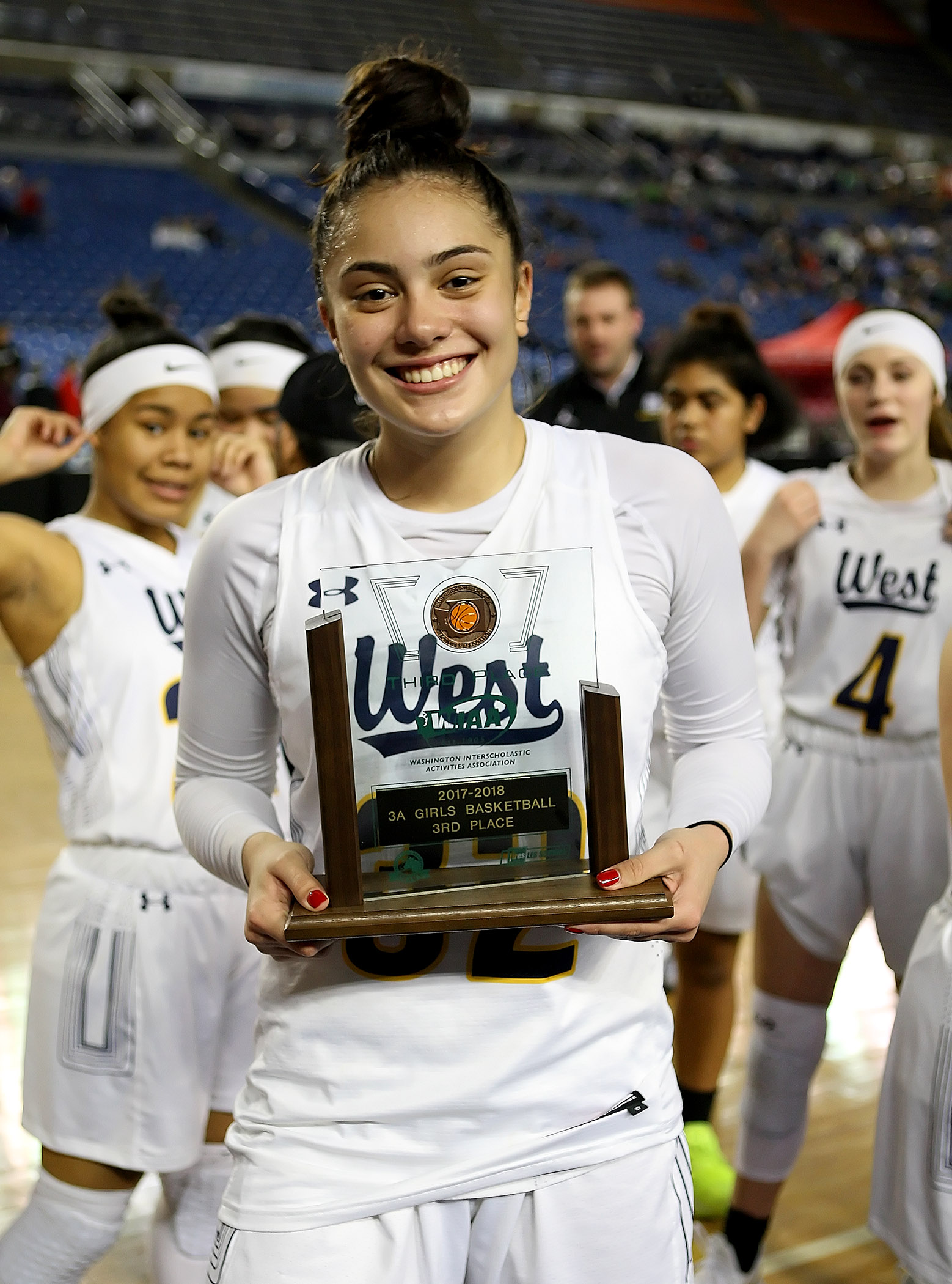 West Seattle's Meghan Fiso shows off the teams 3rd place award.