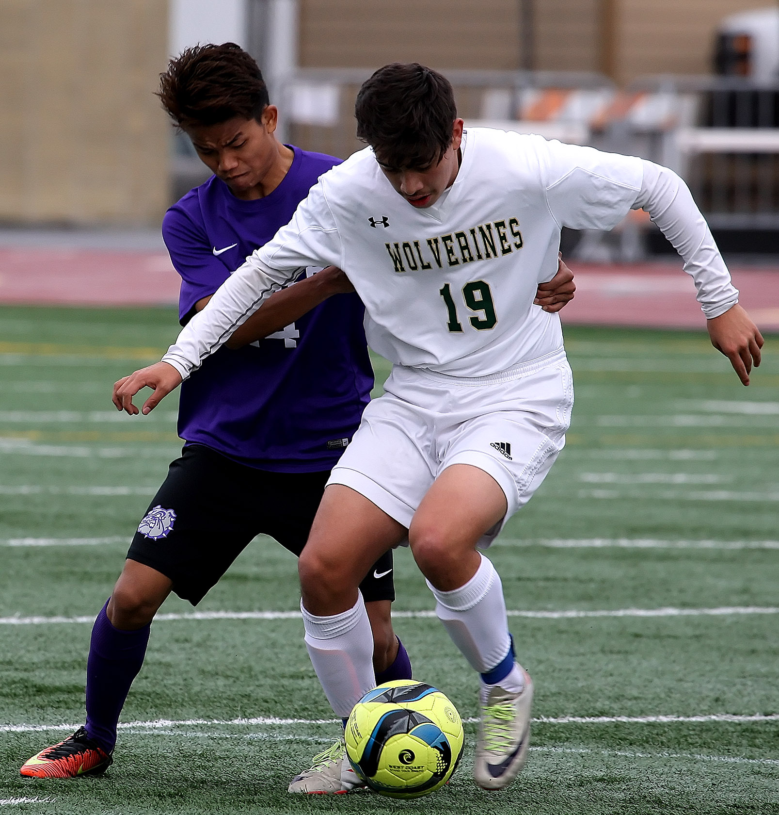 Brian Chicas of Evergreen tries to keep the ball away from Foster's Kum Hnin.