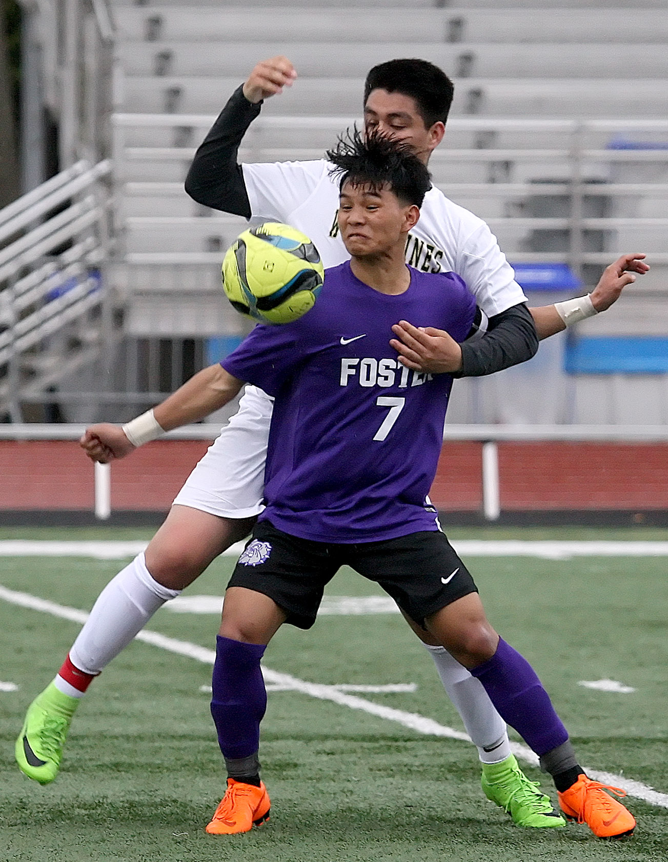 Bik Ceu of Foster blocks Evergreen's Josue Pedroza from getting to the ball.
