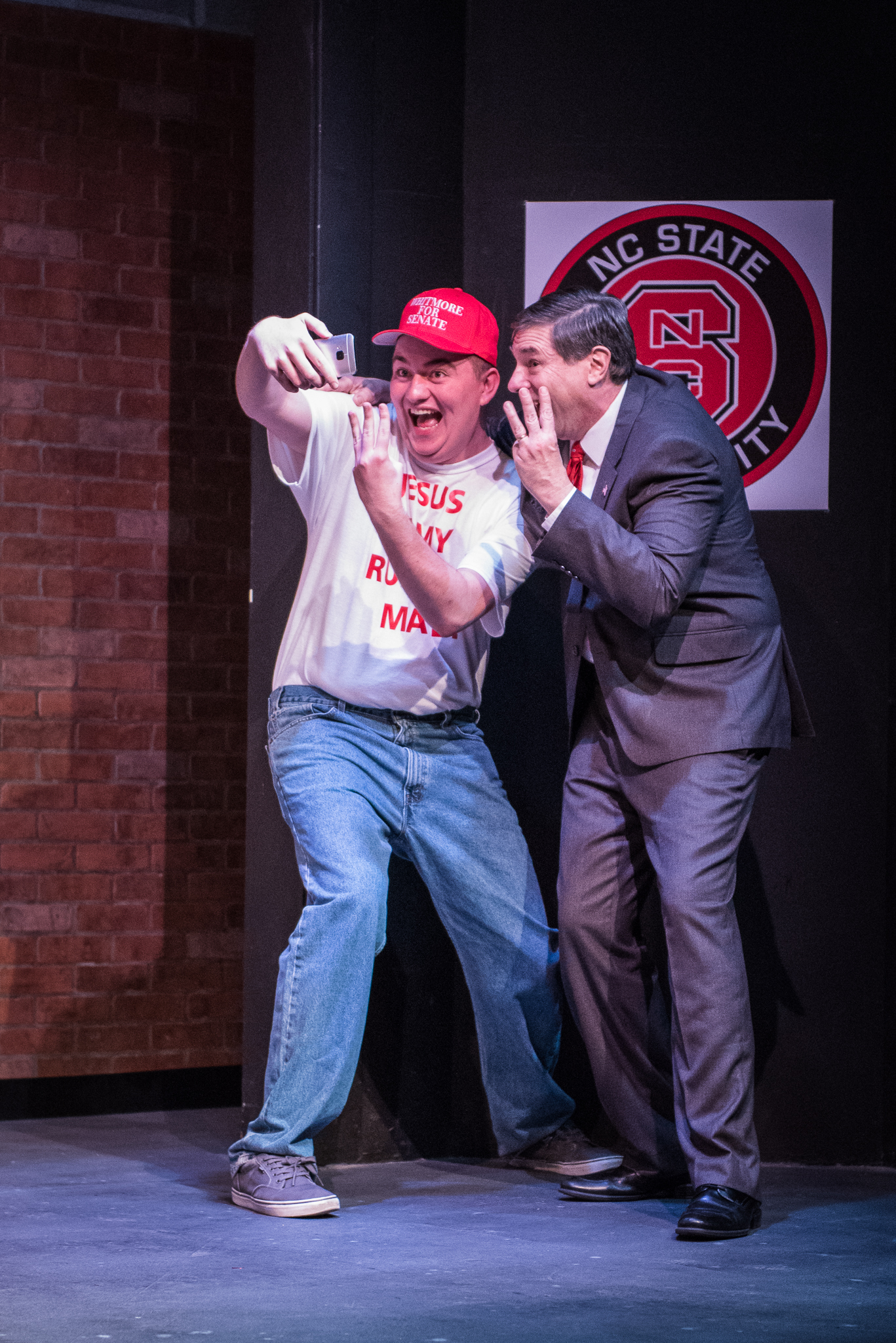 "From left, Tom  (Max Lopuszynski) snaps a selfie with Senator Charles Whitmore (Gianni Truzzi) in the dramedy ""Church & State,"" written by Jason Odell Williams, performing at Burien Actors Theatre  through May 20."