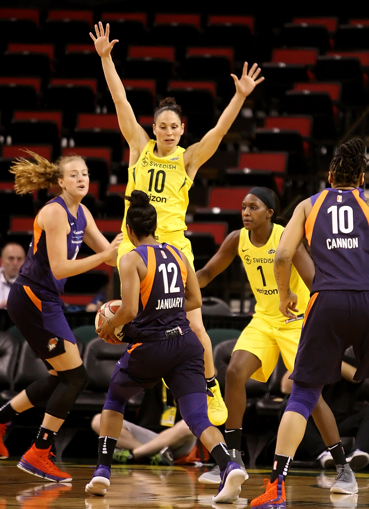 Sue Bird of the Storm goes airborne to disrupt a pass by the Mercury's Briann January.