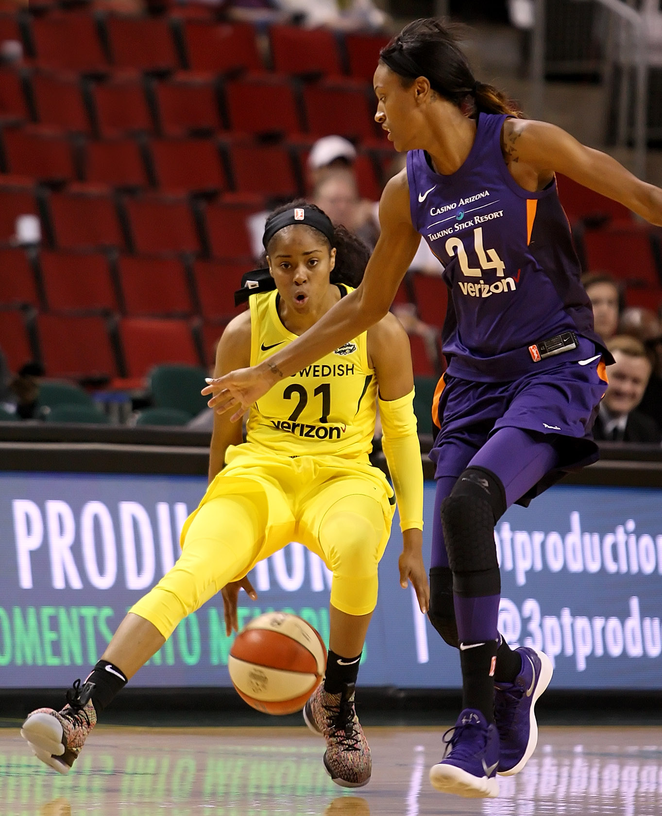 Jordin Canada of the Storm dribbles the ball between her legs against the Mercury's DeWanna Bonner.