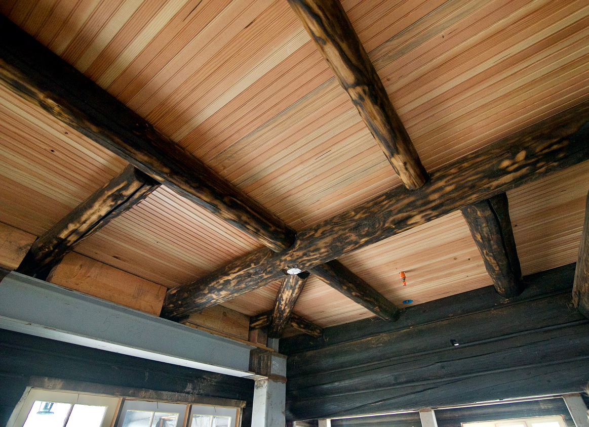 The logs on the ceiling are no longer structural but are the originals. Photo by Patrick Robinson