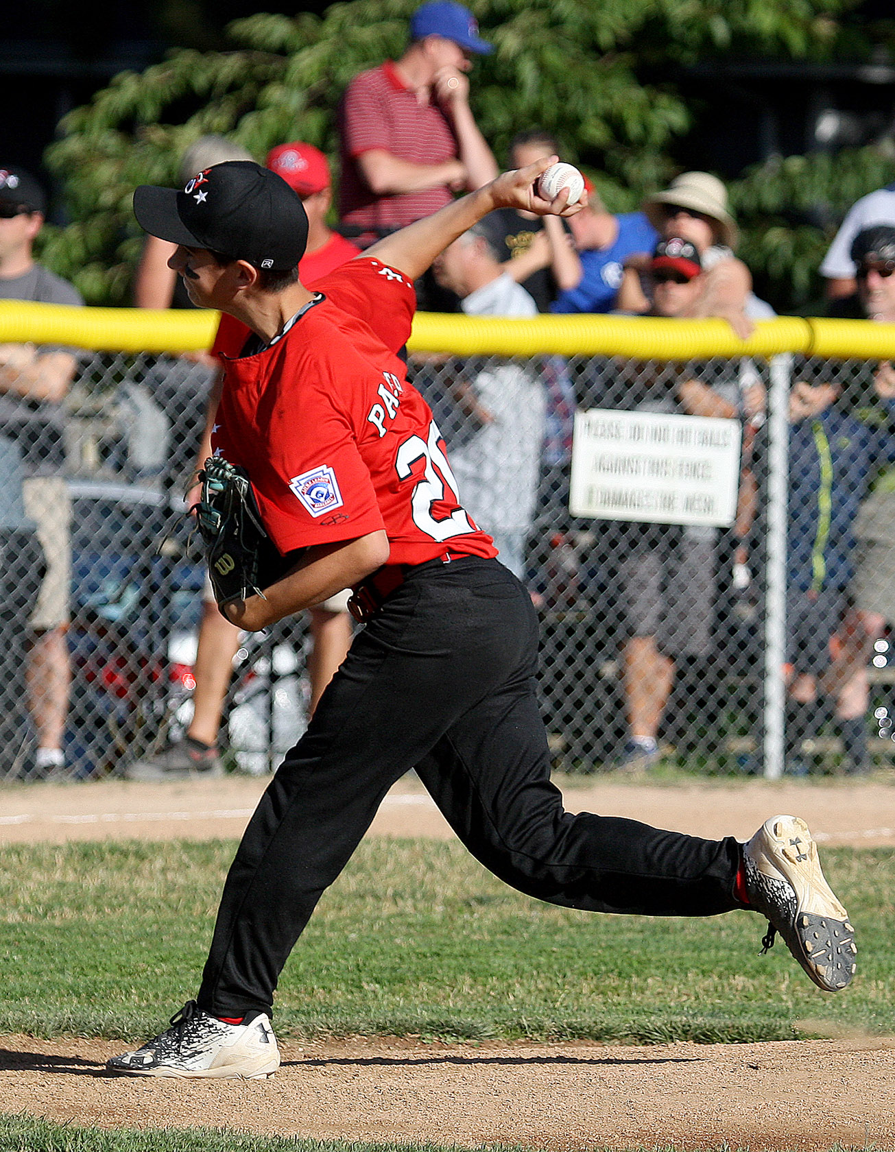 West Seattle's starting pitcher Eli Palmer delivers his pitch home.