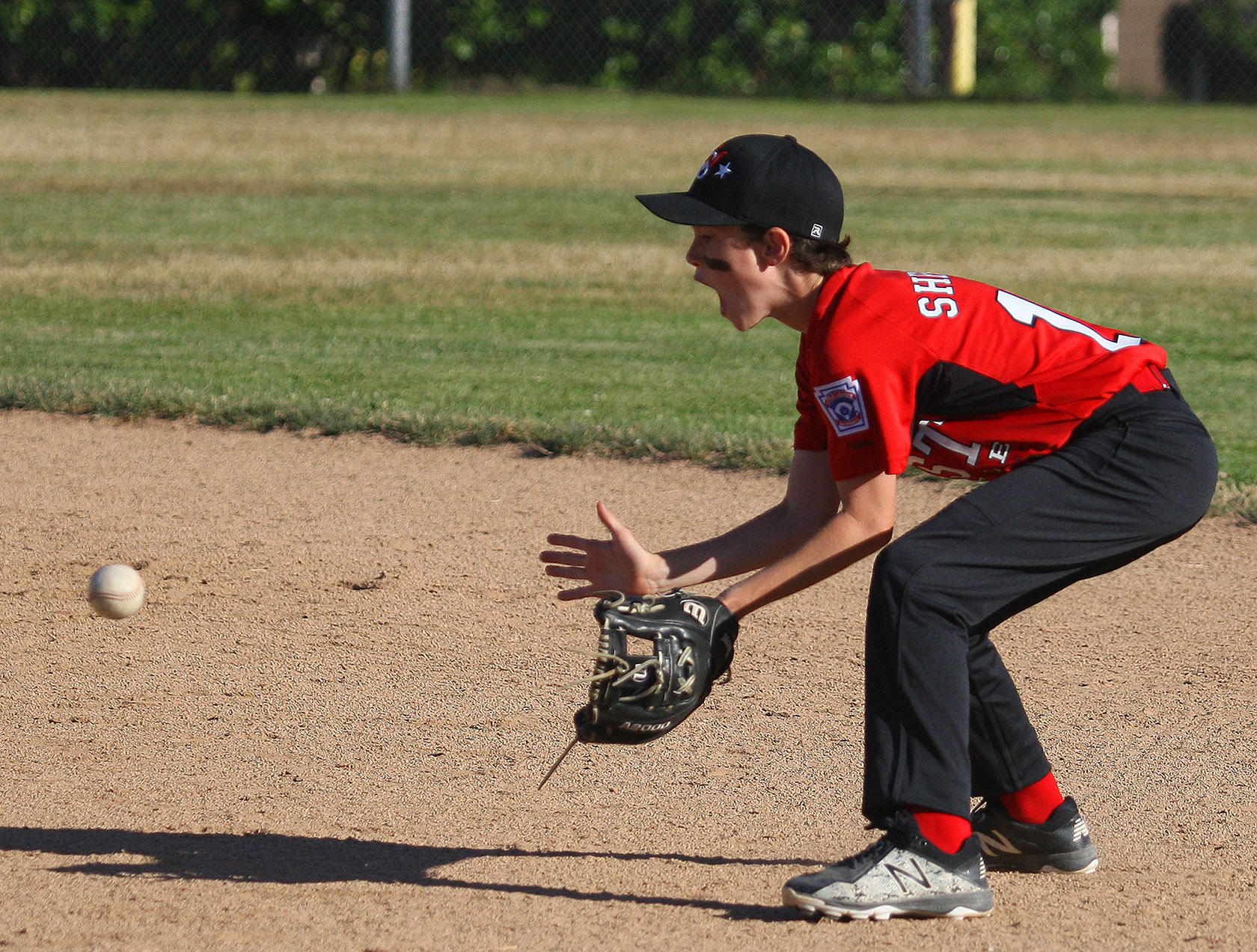 Second baseman Joe Sherick of West Seattle waits for a ground ball.