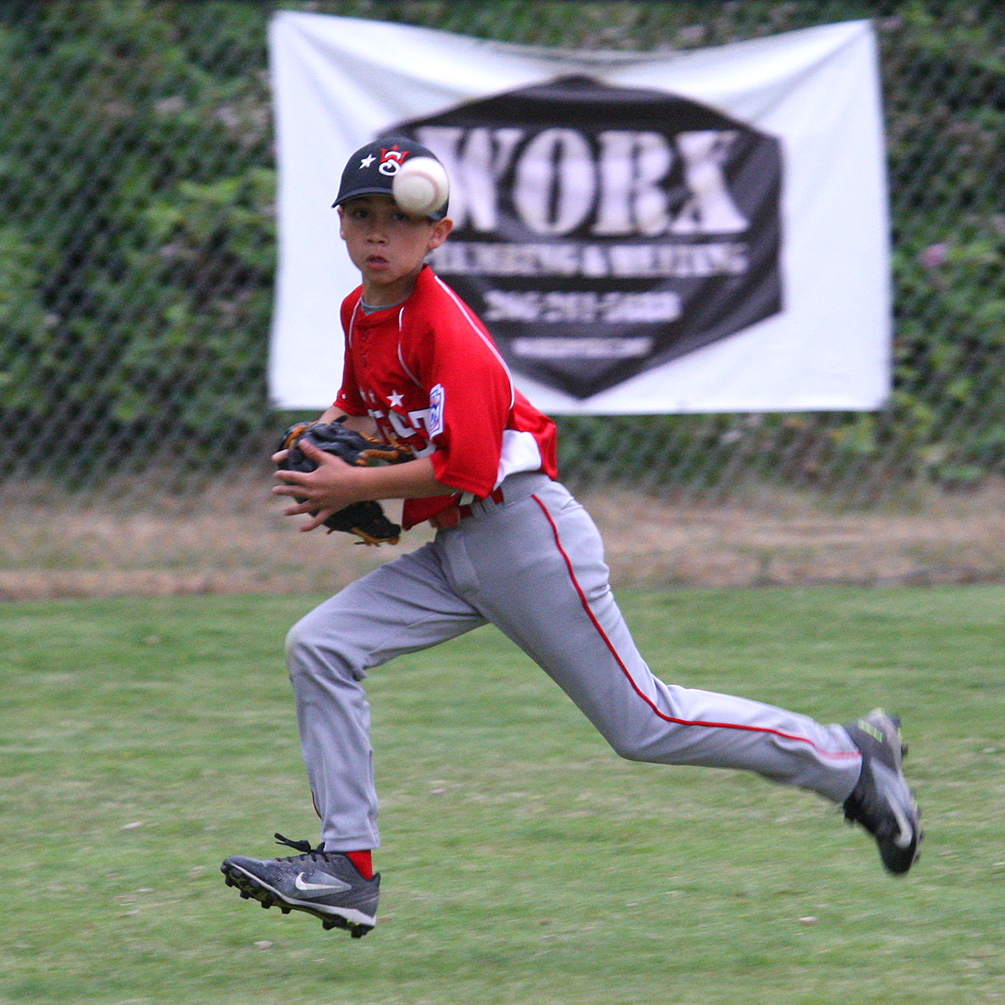 Center fielder Bryce Alonzo of West Seattle keeps his eyes on the ball.