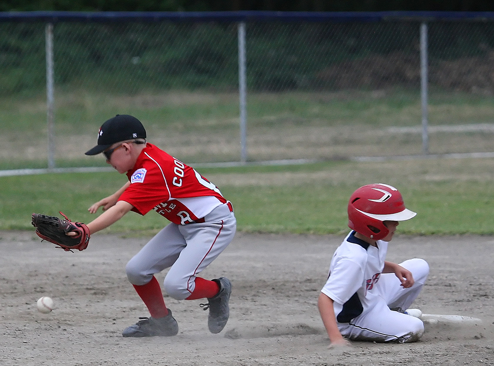 Max Cooper of West Seattle goes after the ball as South Highline Nationals Jayce Fitzgerald gets back to second.