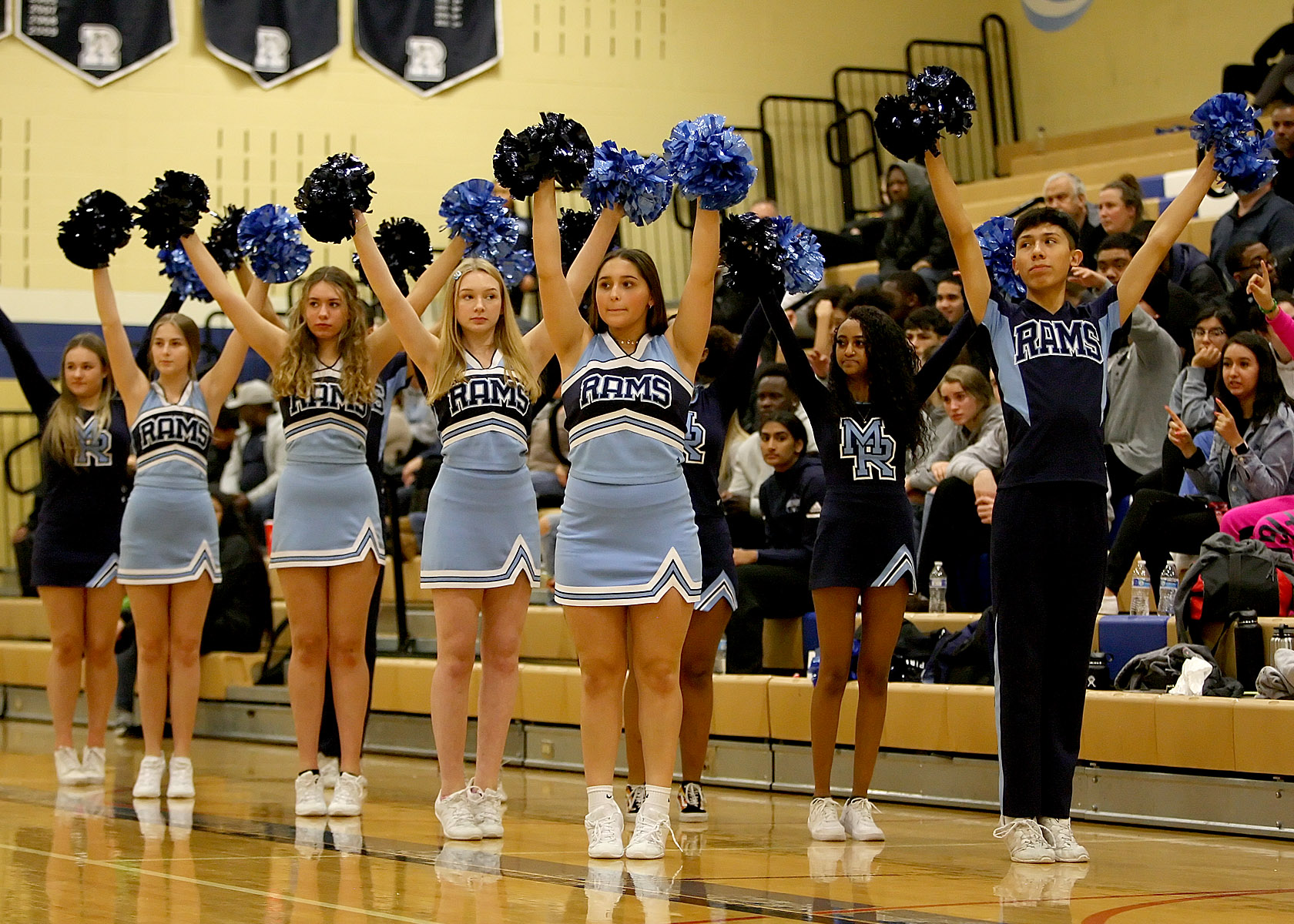 Mt Rainier's cheer leaders raise their pompoms during their teams free throw attempt.