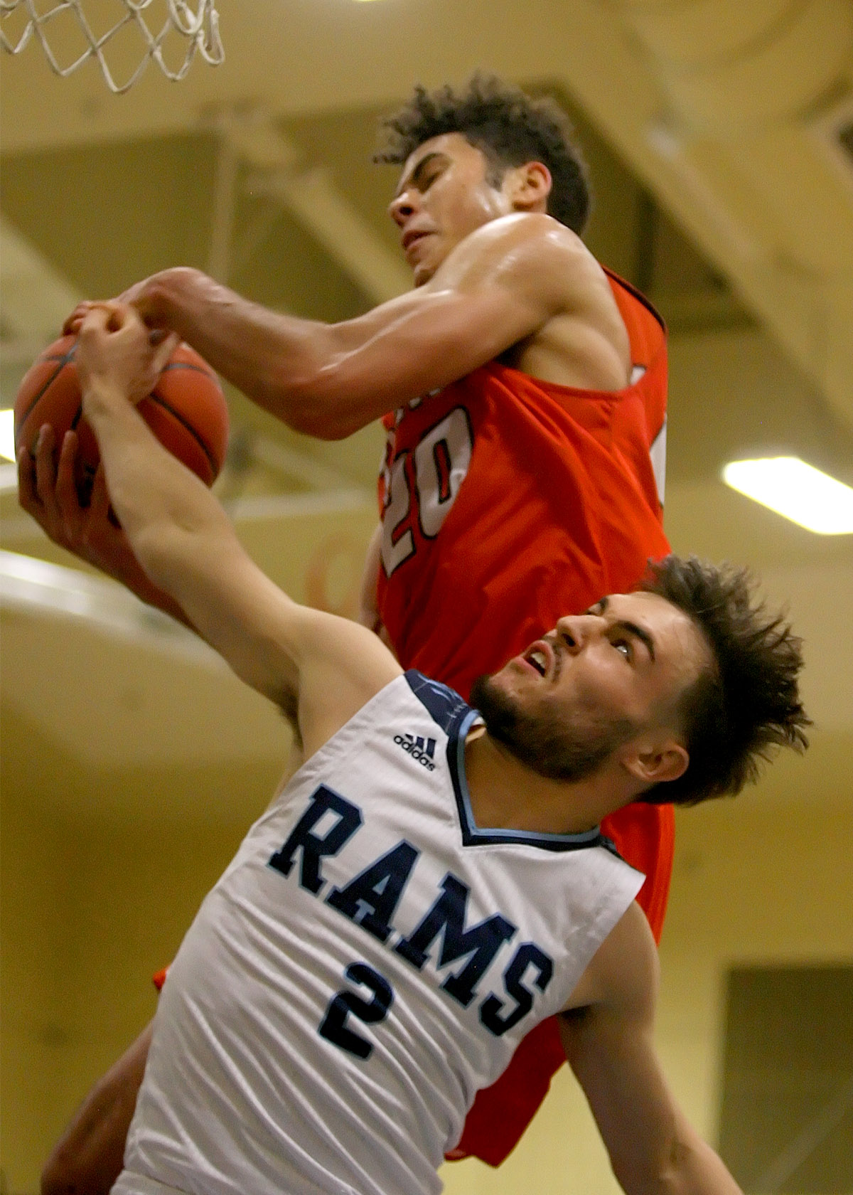 Vincent Orsillo of Mt Rainier reaches back for the ball against Battle Ground's Kaden Perry