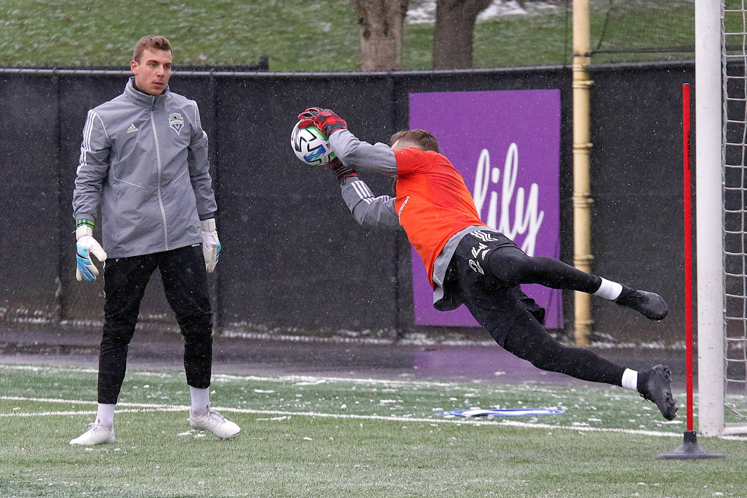 Goalie Stefan Frei (#24) demonstrates a diving save during the first practice of the 2020 season