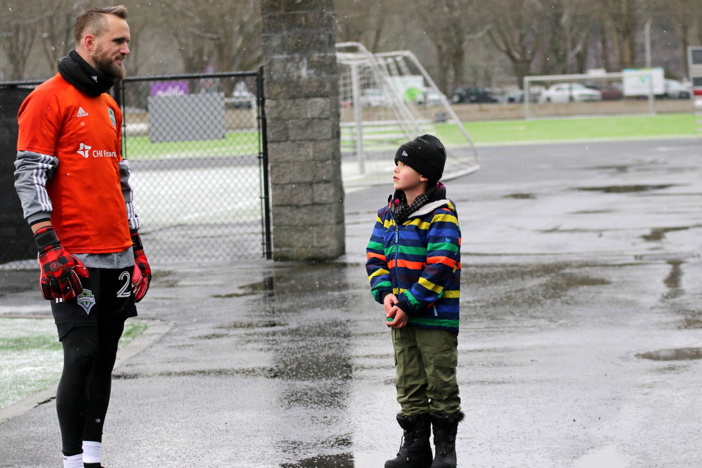 Stefan Frei (#24) talks with fans after practice and meets one aspiring future goalkeeper