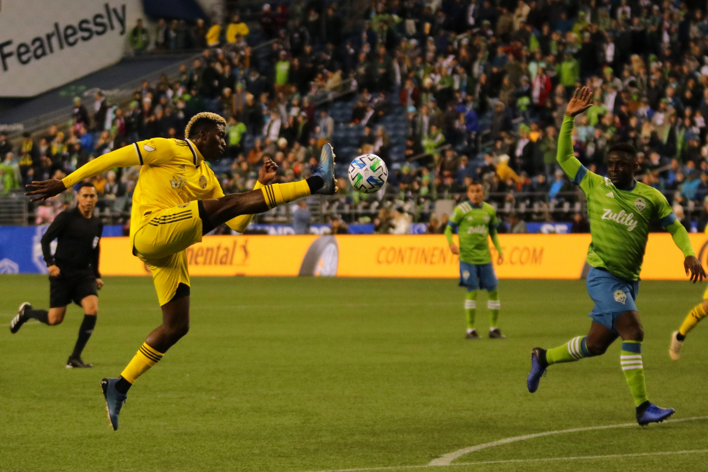Crew Forward Gyasi Zardes (11) attempts to get past the Sounders
