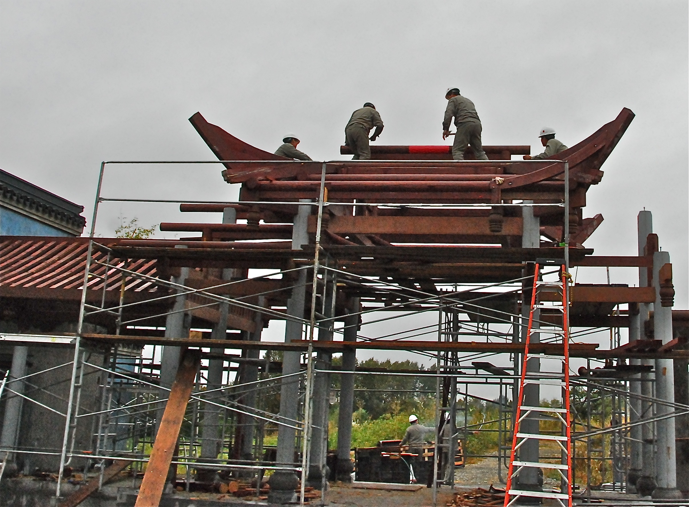the top beam above the ceremonial gate of the knowing the spring courtyard in the seattle chinese garden was placed on aug 31 shortly after 5 pm - Seattle Chinese Garden