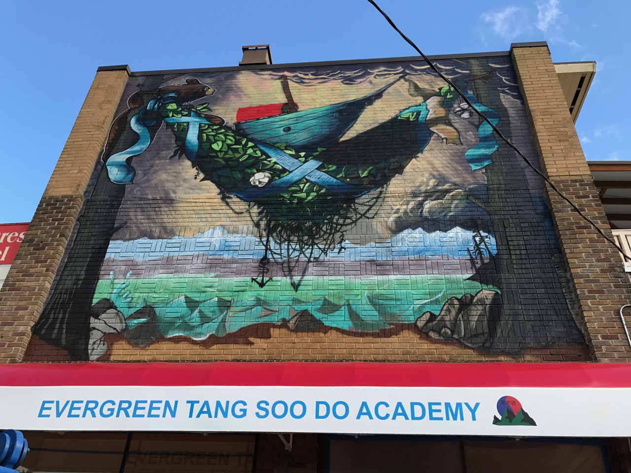New mural makes wall in Admiral District more beautiful if a bit