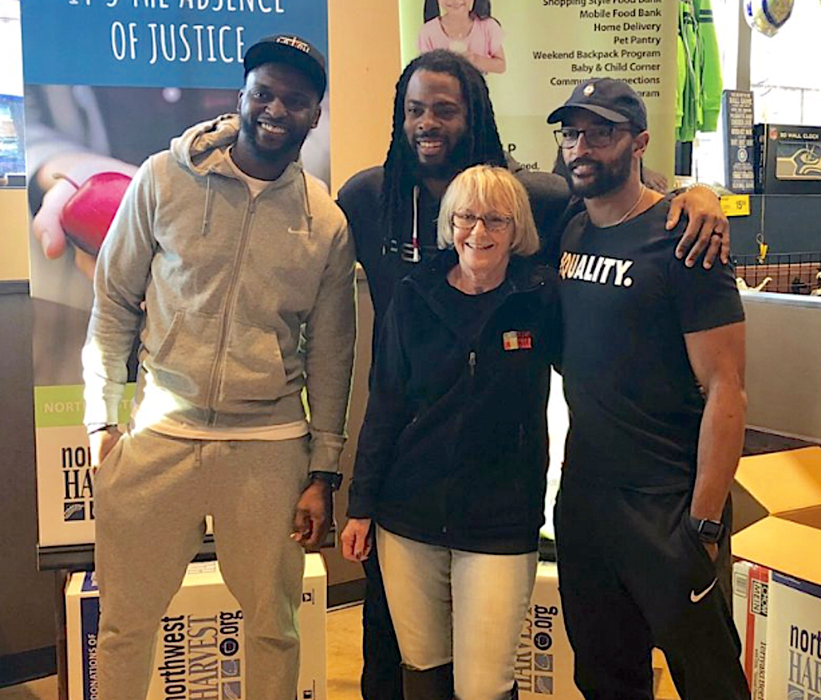 Judi is a huge Seahawks fan - here with Cliff Avril, Richard Sherman and Doug Baldwin at NW Harvest / Safeway Food Drive