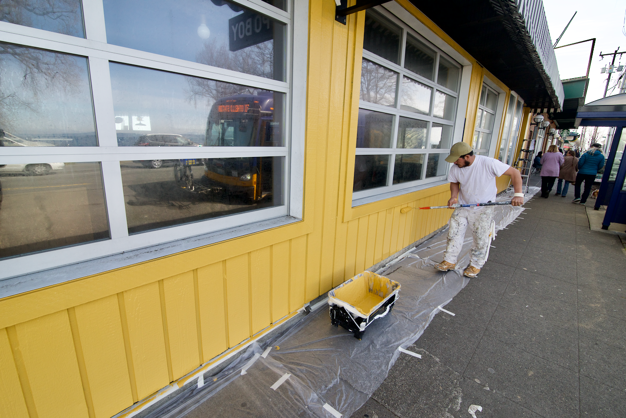Painting the exterior at Alki Chicken and Waffles